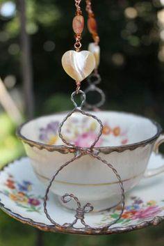 Floral Vintage Tea Cup Bird feeder, Garden art, Upcycle Bird Feeder. $22.00, via Etsy.