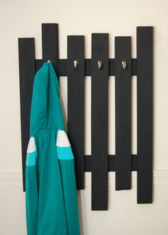 Make your own coatrack like this one using scrap wood. Learn the details here: http://www.planitdiy.com/inspiration/in-organization/pallet-inspired-coat-rack/