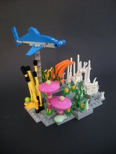 Super Punch: Lego: Hammerhead shark cruising over a coral reef by Shannon Sproule