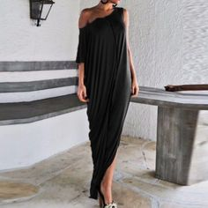 Black Asymmetrical maxi dress The measurement see the third pic. Size L. Material: stretched polyester Dresses Maxi