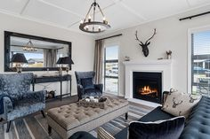Interior Design | Blue Sofa | Blue Armchair | Blue Seats | Open Fire | Fireplace | Textured Ceiling | Luxury Textures | Large Mirror | Living Room Design | Layout Layout, Living Room Inspiration, Design, Home Decor, Page Layout, Interior Design, Design Comics, Home Interior Design