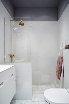 A Stockholm apartment with an industrial touch. Love the grey ceiling and walls. Bathroom Renos, Laundry In Bathroom, White Bathroom, Small Bathroom, Brass Bathroom, Bathroom Ideas, Bad Inspiration, Bathroom Inspiration, Stockholm Apartment
