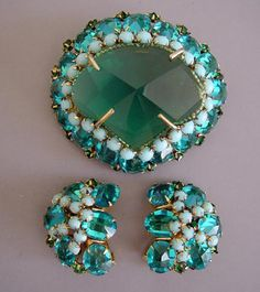 SCHREINER aqua & green rhinestones brooch & earrings from Morning Glory Jewelry. Buy now for $348.00