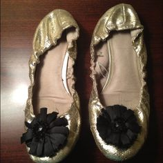 Metallic Gold Gap flats Adorable and worn once! Gold stretchy flats with black flower. No signs of wear. Size 8NO TRADES GAP Shoes Flats & Loafers