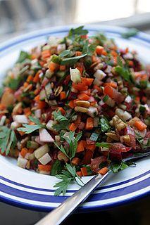 israeli salad (w. carrots, beet, radishes, cucumber, tomato, arugula, mixed nuts, herbs, & goat or feta cheese)