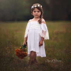 I think the Mia dress is an adorable white flower girl dress for a boho wedding! This beautiful cotton girl's dress is oh so soft and sassy, from the fancy dresses for girls collection. The neckline i