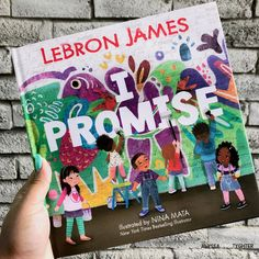 Featuring James's upbeat, rhyming text and vibrant illustrations perfectly crafted for a diverse audience by New York Times bestselling artist Nina Mata, this book has the power to inspire all children and families to be their best.  Perfect for shared reading in and out of the classroom, I Promise is also a great gift for graduation, birthdays, and other occasions.  📸 @alyssagtyghter Lebron James Mother, Baby Name Book, Books Everyone Should Read, Local Legends, Dinosaur Costume, Shared Reading, Children And Family, Picture Books, I Promise