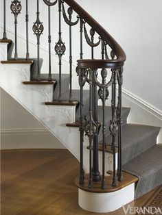 This railing was modeled after one in a historic house in Nashville, but we simplified the design and changed it to include swags, eagles and pineapples. The metalwork by Les Métalliers Champenois is an example of great craftsmanship in bronze. Wood Railings For Stairs, Iron Staircase, Stair Railing Design, Iron Stair Railing, Wrought Iron Stairs, Bannister, Stair Handrail, Grades, Foyer Decorating