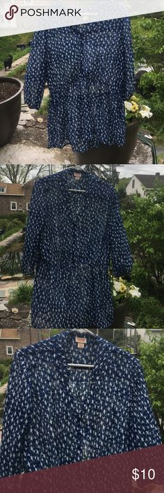 Translucent blue top with bird print. Translucent blue top with bird print. Very flattering, but needs a talk under it. Hits below the waist, and has three quarter sleeves. Mossimo Supply Co Tops Blouses