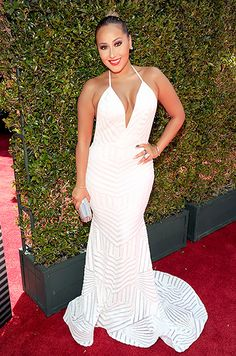 Adrienne Bailon went glam at the 2014 BET Awards, rocking a floor-length white Michael Costello gown with a train.
