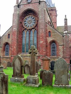 St. Magnus Cathedral, Kirkwall, Orkney Island, Scotland. Loved the old wooden doors and the daisy shaped wndows.