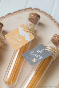 Honey Test Tube Favors and Free Printable Bee Tags. Make these bee.autiful honey favors using honey sticks and test tubes. Perfect to give away at weddings, birthdays, and shower. Get the printable at thebeautydojo.com