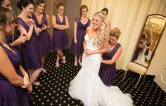 getting ready with bridesmaids before her wedding
