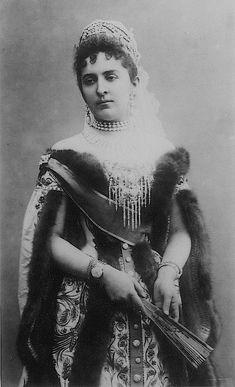 Grand Duchess Anastasia of Mecklenburg-Schwerin, wears a fur-trimmed Russian court dress with a spectacular diamond brooch