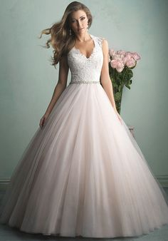 This is truly the ballgown of a princess Ñ a gauzy tulle skirt topped with an incredibly gorgeous lace bodice and a sheer, beaded back. A delicate band encircles the waist, adding extra sparkle.