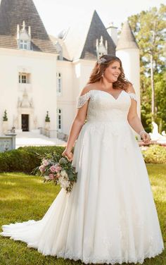 Completely romantic, figure-flattering and totally unique, this plus-size A-line gown is a one-of-a-kind dream come true. From designer Stella York, this lace and tulle over regency organza wedding dress highlights the bride's natural beauty with off-the-shoulder straps and an modern sweetheart neckline. A detailed lace hem gives this dress an air of romance, while the lace is both soft and subtle. Western Wedding Dresses, Sexy Wedding Dresses, Perfect Wedding Dress, Full Figure Wedding Dress, Wedding Dress Organza, Bridal Dresses, Beach Dresses, Stella York Wedding Gowns, Anne Laure