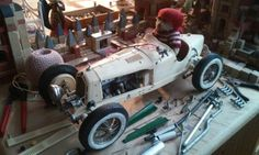Sometimes it looks like this on our worktable...Wolf is building a fancy vintage racing car for Lund, one of our resident bears...