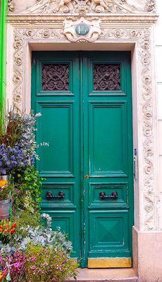 Emerald green door in Paris, France.