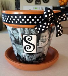 mod podge pics to a flower pot, cute gift idea.--might be cute to do for a teacher with kids from the class