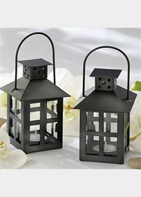 Let your event bask in the glow of this contemporary take on an antique design. You'll be amazed at the ambience created at your tables by simply lighting a tea candle in this mini lantern. Oh, what a night you'll have! Decorative lantern is skillfully crafted from matte-black metal and glass. Lantern measures approximately 7 h (with handle extended) x 3 square. Tea light not included. Maximum burn time is approximately 2 hours.