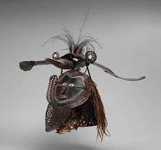 Mask (Buk, Krar, or Kara) Date: mid to late 19th century Geography: Australia, Mabuiag Island, Queensland, Torres Strait Culture: Torres Strait Islander Medium: Turtle shell, wood, cassowary feathers, fiber, resin, shell, paint Dimensions: H. 21 1/2 x W. 25 x D. 22 3/4 in. (54.6 x 63.5 x 57.8 cm) Classification: Costumes Credit Line: The Michael C. Rockefeller Memorial Collection, Purchase, Nelson A. Rockefeller Gift, 1967 Accession Number: 1978.412.1510