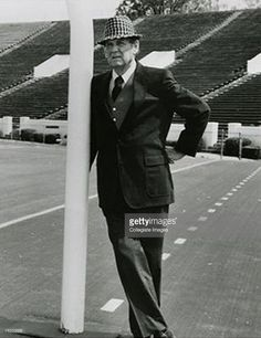Paul 'Bear' Bryant, head coach of the University of Alabama Crimson Tide from 1958 - 82., leans on a gold post at Bryant-Denny Stadium in Tuscaloosa, Alabama.