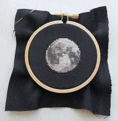 cross stitch moon in 3 inch embroidery hoop on black 13 count aida This lovely moon cross stitch pdf pattern only uses 6 different DMC colors. If you use 14 count aida the finished piece will be only inch big. Embroidery Transfers, Diy Embroidery, Cross Stitch Embroidery, Embroidery Patterns, Modern Cross Stitch, Cross Stitch Designs, Cross Stitch Patterns, Cross Stitch Moon, Broderie Simple