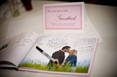 well this is clever - Create a photo book of your engagement photos to use as the guest book.