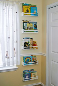 $4 IKEA Spice Racks Turned Kids Bookshelves. I would put them all at a reachable or UNreachable levels!