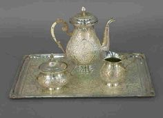 Lot:259: 4 pc. Egyptian Sterling Tea Service, Lot Number:259, Starting Bid:$600, Auctioneer:Dallas Auction Gallery, Auction:259: 4 pc. Egyptian Sterling Tea Service, Date:12:30 PM PT - Nov 19th, 2003