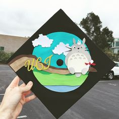 Pin for Later: Studio Ghibli Cap-Decorating Ideas For Extraspirited Graduates Totoro on a Branch Custom Graduation Caps, Graduation Cap Designs, Graduation Cap Decoration, Graduation Diy, Funny Grad Cap Ideas, Funny Ideas, Cap Decorations, Cap And Gown, Studio Ghibli