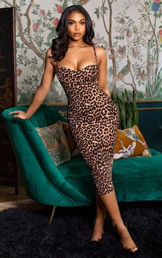 Make a bold statement in this midi dress. Featuring a leopard print material with thin straps, cup detailing and a figure-hugging fit. Team this with barely-there heels and a mini bag to complete the look. Leopard Print Outfits, Leopard Dress, Leopard Clothes, Leopard Prints, Going Out Dresses, Cute Dresses, Women's Dresses, Dresses Online, Elegant Midi Dresses