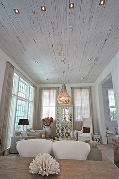 beach house; love the white washed wood ceiling