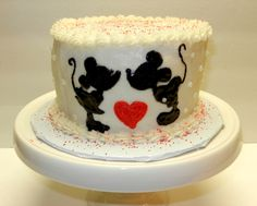 Perfect cake for two! Mickey and Minnie Mouse kissing.