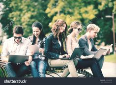 Summer, Internet, Education, Campus And Teenage Concept - Group Of Students Or Teenagers With Laptop And Tablet Computers Hanging Out Стоковые фотографии 222048700 : Shutterstock