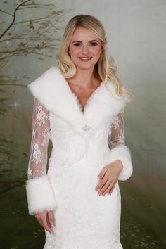 Lace & Faux Fur Shrug – Richard Designs A gorgeous lace shrug with faux fur cuffs and collar. Finished with a crystal brooch at the centre. Faux Fur Shrug, Lace Shrug, Crystal Brooch, Bridesmaid Dresses, Wedding Dresses, Lace Weddings, Fur Fashion, Vintage Looks, White Dress
