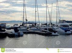 Evening at the Harbor stock photo. Image of diversity - 101944114 Small Yachts, Burlington Vermont, Lake Champlain, Motor Boats, Sailing Ships, Stock Photos, Water, Image, Fountain Powerboats
