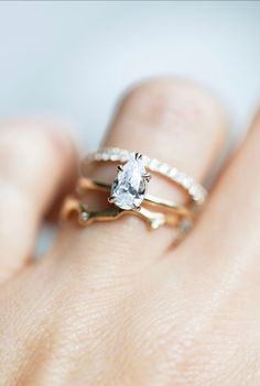 The perfect Pear. Our Laurel setting is dainty and timeless. This solitaire is set apart from the rest! Paired here with the White Diamond Twinkle Band and organic Limu Eternity Ring. All rings available in 14k yellow gold, white gold and rose gold.