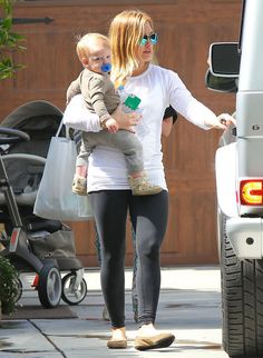 Hilary Duff Cuddles Sleepy Luca on a Sweet Mother-Son Outing: Hilary Duff carried Luca to the car.