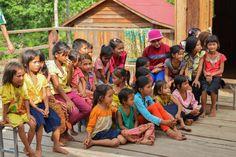 Colourfully dressed school children Dor Village Cambodia