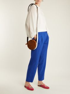 Click here to buy Diane Von Furstenberg Circle leather and suede cross-body bag at MATCHESFASHION.COM