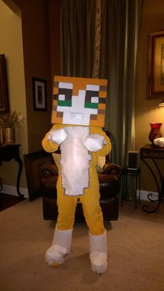 Minecraft Mr. Stampy Cat (aka Stampy Longnose, aka Stampy Longhead). Halloween 2014 costume made for my son. Orange sleeper with white felt, painted box head, and hand-sewn block paws and boots to fit over hands and shoes.
