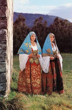 Europe | Portrait of two young women wearing traditional clothes and headscarfs, Sicily, Italy