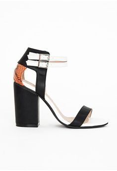 """Look fierce in these black heeled sandals this season. With chic contrasting white double ankle straps, bold block heel, cut out feature and tan croc detail to the ankle these heels are seriously standout.   Approx heel length 10.5cm/4"""" ..."""
