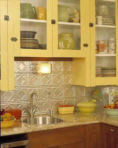 Love the yellow and the tin tile back splash, I have antique ceiling tiles  to