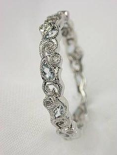 Right hand stack ring from Isla (her birthstone)  Beverley K Aquamarine Eternity Band