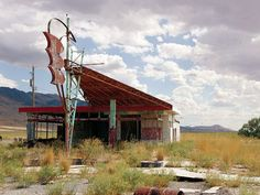 Googie: Gas station located on the south side of about halfway between Salt Lake City and Wendover in Utah. Old Buildings, Abandoned Buildings, Abandoned Places, Abandoned Vehicles, Route 66, Pompe A Essence, Old Gas Pumps, Gas Service, Old Gas Stations
