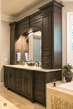 Traditional double vanity with arch and storage towers in master bath remodeled by KBF Design Gallery vanities Master Master Bathroom Vanity, White Bathroom Cabinets, Bathroom Renos, Bathroom Renovations, Home Remodeling, Bathroom Vanities, Bathroom Storage, Bathroom Fixtures, Bathroom Black