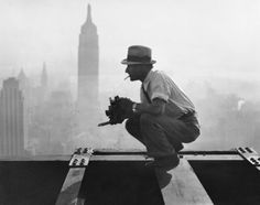 """Charles Ebbets shooting his famous photograph, """"Lunch atop a Skyscraper"""", while perching on the 69th floor of the GE building. 1932"""