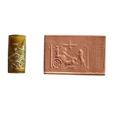 """This official cylinder seal made with agate was discovered in Egypt, was used for rolling an impression on clay tablets. The seal shows the king hunting a lion from his chariot, inscribed, """"Darius the great king"""", in Old Persian, Elamite and Babylonian cuneiform, the three official languages of the Persian empire.  Aghate Cylinder Seal 5s bc thebes"""